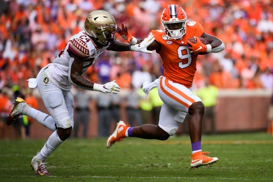 Clemson running back Travis Etienne (9) attempts to evade Florida State defensive back Cyrus Fagan(24) during their game at Memorial Stadium Saturday, October 12, 2019.