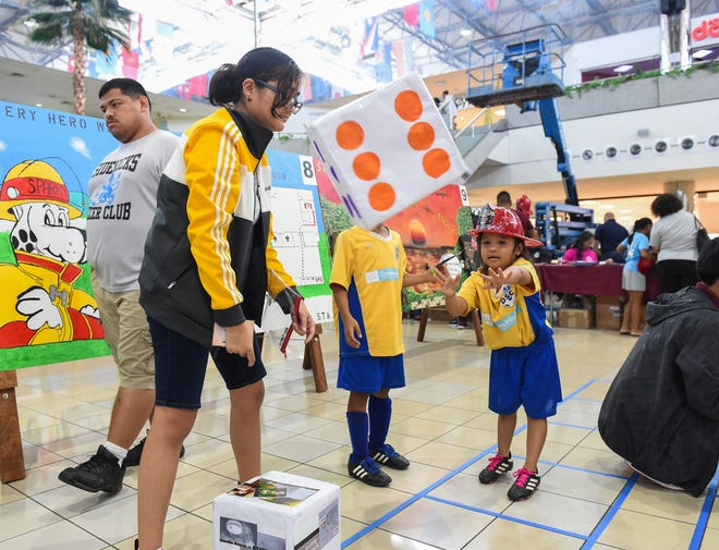 Six-year-old Brielle Benavente participates in a fire safety dice game during Fire Prevention Week at the Micronesia Mall in Dededo, Oct. 12, 2019.