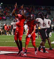 Petal Panthers quarterback Decarlos Nicholson celebrates after scoring the first touchdown of the game against the Brandon Bulldogs Oct. 11, 2019.