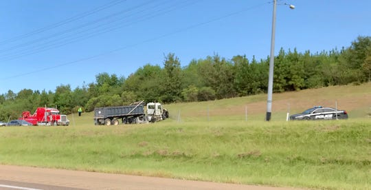 A dump struck comes to a stop on the frontage road after being involved in a crash on I-20 in Clinton.