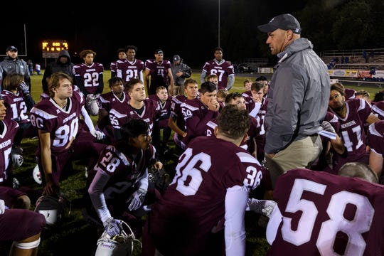 Henderson County Head Coach Josh Boston talks to his team following their 20-13 win over the Apollo Eagles at Colonels Stadium in Henderson, Ky., Friday, Oct. 11, 2019.