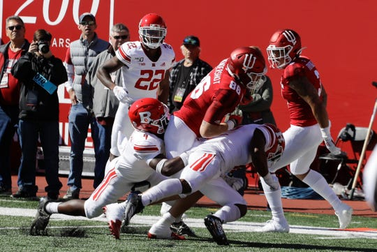 Indiana tight end Peyton Hendershot (86) goes in for a touchdown while being tackled by Rutgers defensive back Tre Avery (4) and defensive back Christian Izien (12) during the first half of an NCAA college football game, Saturday, Oct. 12, 2019, in Bloomington, Ind. (AP Photo/Darron Cummings)