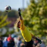 North Central High School senior Alan Johnson (1) watches as the ball slips past him and into the goal on a Zionsville goal during an IHSAA boys' soccer sectional championship at Pike High School, Saturday, Oct. 12, 2019. Zionsville defeated North Central 2-1.