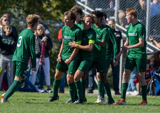 Zionsville High School senior Chris Freeman (6) celebrates scoring a goal with his teammates during an IHSAA boys' soccer sectional championship at Pike High School, Saturday, Oct. 12, 2019. Zionsville defeated North Central 2-1.