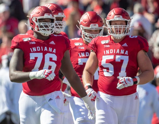 Matthew Bedford of the Indiana Hoosiers (left), and Harry Crider, during game action, Rutgers at Indiana University football, Bloomington, Saturday, Oct. 12, 2019. Indiana won 35-0.