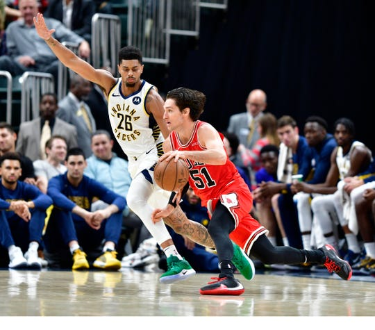 Oct 11, 2019; Indianapolis, IN, USA; Chicago Bulls guard Ryan Arcidiacono (51) drives the ball toward the basket against Indiana Pacers guard Jeremy Lamb (26) during the second quarter of the game at Bankers Life Fieldhouse. Mandatory Credit: Marc Lebryk-USA TODAY Sports