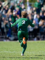 Zionsville High School junior Alex Carr (3) runs towards the fans in the stands to celebrate scoring the team's go-ahead goal during an IHSAA boys' soccer sectional championship at Pike High School, Saturday, Oct. 12, 2019. Zionsville defeated North Central 2-1.