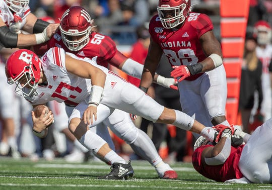 Johnny Langan of the Rutgers Scarlet Knights, is brought down on this sack during the second half, Rutgers at Indiana University football, Bloomington, Saturday, Oct. 12, 2019. Indiana won 35-0.