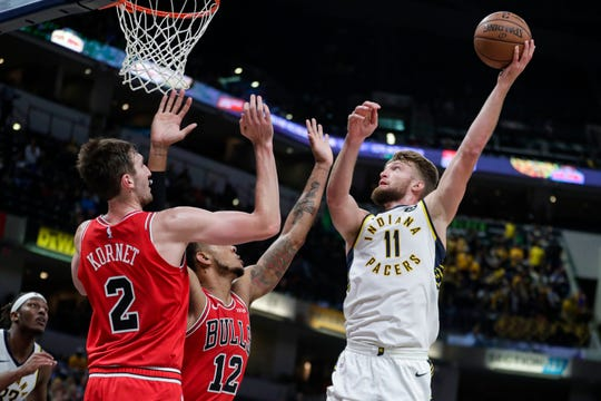 Indiana Pacers forward Domantas Sabonis (11) shoots over Chicago Bulls forward Luke Kornet (2) and forward Daniel Gafford (12) during the first half, Friday, Oct. 11, 2019.