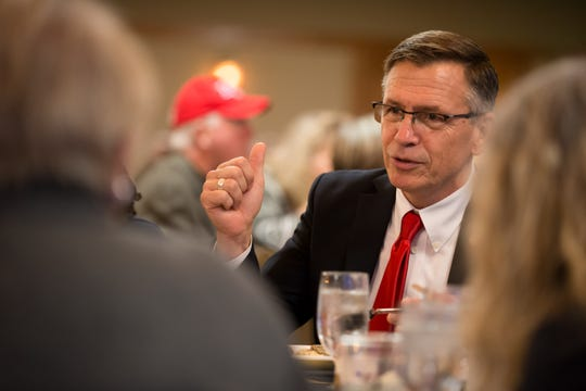 Bobby Schilling speaks with supporters during the Johnson County Republicans dinner at Brown Deer Golf Course in Coralville on October 11, 2019.