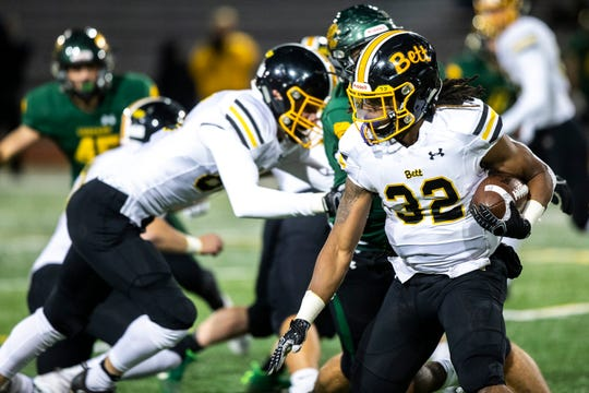 Bettendorf's Harrison Bey-Buie (32) rushes during a Class 4A varsity football game, Friday, Oct., 11, 2019, at Kingston Stadium in Cedar Rapids, Iowa.