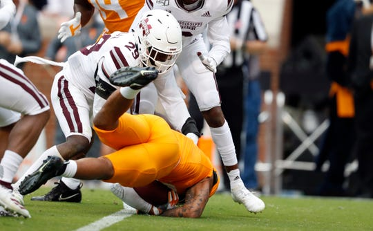 Tennessee running back Tim Jordan (9) dives into the end zone for a touchdown as he's hit by Mississippi State safety C.J. Morgan (29) in the first half of an NCAA college football game Saturday, Oct. 12, 2019, in Knoxville, Tenn. (AP Photo/Wade Payne)