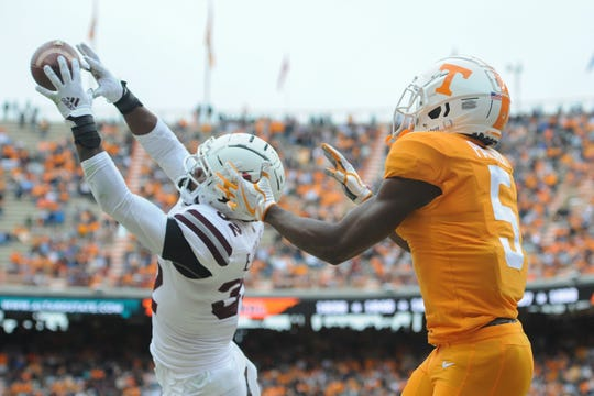 Mississippi State safety Brian Cole II (32) intercepts a pass in the end zone against Tennessee Volunteers wide receiver Josh Palmer (5) during the second quarter at Neyland Stadium.
