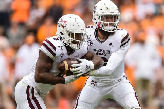 Oct 12, 2019; Knoxville, TN, USA; Mississippi State Bulldogs running back Kylin Hill (8) takes a hand off from quarterback Garrett Shrader (6) in the fourth quarter of a game against the Tennessee Volunteers at Neyland Stadium. Mandatory Credit: Bryan Lynn-USA TODAY Sports