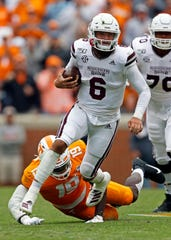 Mississippi State quarterback Garrett Shrader (6) escapes the grasp of Tennessee linebacker Darrell Taylor (19) as he runs for yardage in the second half of an NCAA college football game Saturday, Oct. 12, 2019, in Knoxville, Tenn. (AP Photo/Wade Payne)