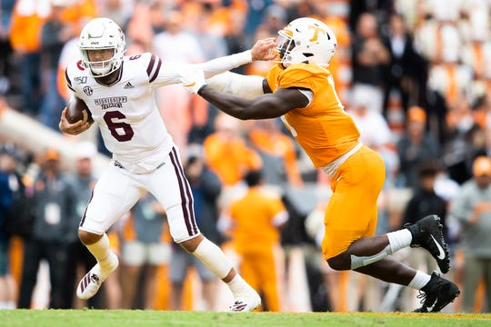 Mississippi State quarterback Garrett Shrader (6) pushes away Tennessee linebacker Darrell Taylor (19) during a game between Tennessee and Mississippi State in Neyland Stadium in Knoxville, Tenn. on Saturday, October 12, 2019.