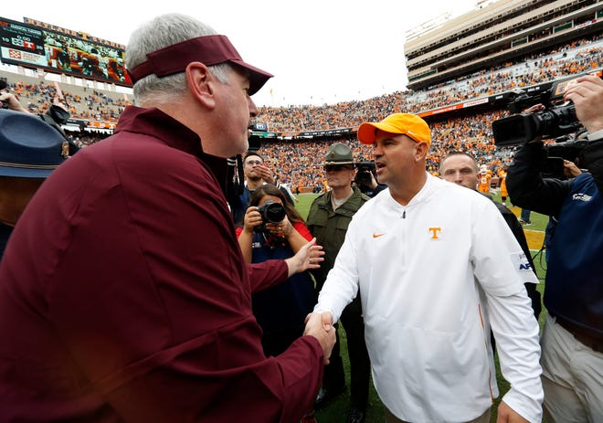 Tennessee head coach Jeremy Pruitt, right, is congratulated by Mississippi State head coach Joe Moorhead after an NCAA college football game Saturday, Oct. 12, 2019, in Knoxville, Tenn. Tennessee won 20-10.