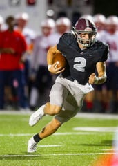 Bearden's Collin Ironside looks for yardage in a 42-22 win over Jefferson County on Oct. 11. Even after losing their first five games, the Bulldogs kept their playoff hopes alive.