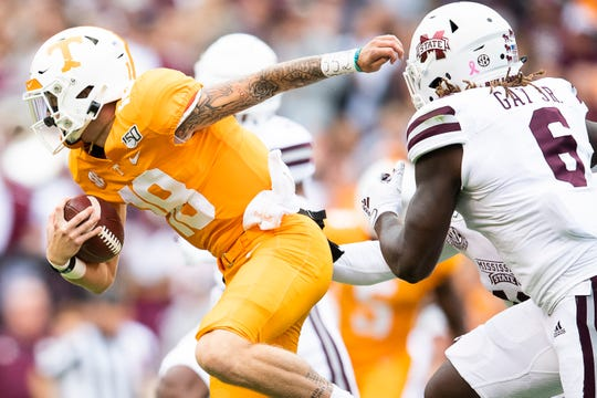 Tennessee quarterback Brian Maurer (18) breaks past Mississippi State linebacker Willie Gay Jr. (6) during a game between Tennessee and Mississippi State in Neyland Stadium in Knoxville, Tenn. on Saturday, October 12, 2019.