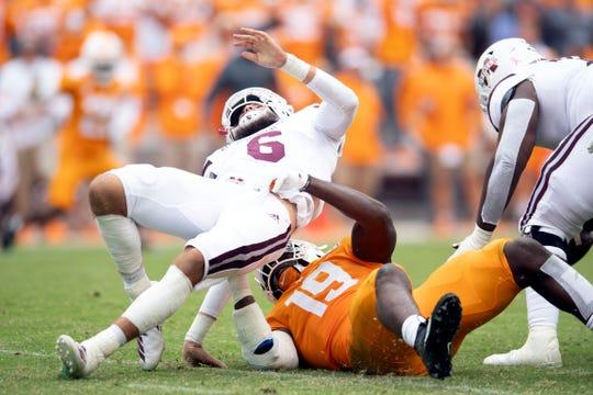 Mississippi State quarterback Garrett Shrader (6) is sacked by Tennessee linebacker Darrell Taylor (19) on Saturday, October 12, 2019.