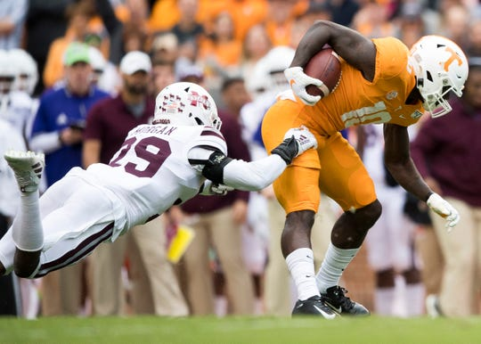 Mississippi State safety C.J. Morgan (29) tries to tackle Tennessee wide receiver Tyler Byrd (10) during Tennessee's home game against Mississippi State at Neyland Stadium on Saturday, October 12, 2019.