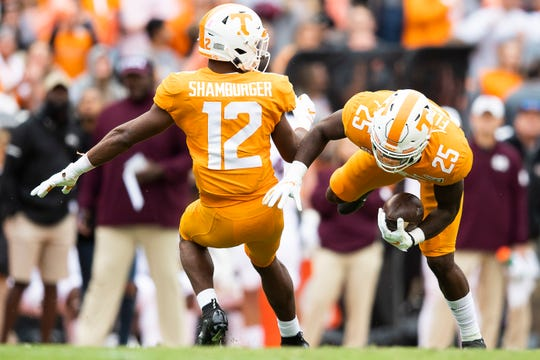 Tennessee defensive back Trevon Flowers (25) intercepts a pass as Tennessee defensive back Shawn Shamburger (12) defends during a game between Tennessee and Mississippi State in Neyland Stadium in Knoxville, Tenn. on Saturday, October 12, 2019.