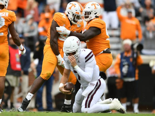 Tennessee defensive lineman Matthew Butler (94) and Tennessee defensive lineman Greg Emerson (90) celebrate after sacking Mississippi State quarterback Tommy Stevens (7) during Tennessee's home game against Mississippi State at Neyland Stadium on Saturday, October 12, 2019.