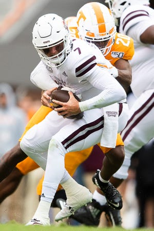 Mississippi State quarterback Tommy Stevens (7) is sacked by Tennessee defensive back Bryce Thompson (20) during a game between Tennessee and Mississippi State in Neyland Stadium in Knoxville, Tenn. on Saturday, October 12, 2019.