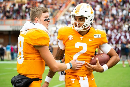 Tennessee quarterback Jarrett Guarantano (2) is congratulated by Tennessee quarterback Brian Maurer (18) during a game between Tennessee and Mississippi State in Neyland Stadium in Knoxville, Tenn. on Saturday, October 12, 2019.