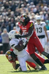 Purdue running back Tario Fuller (25) is taken down by Maryland linebacker Ayinde Eley (16) and Maryland defensive lineman Brett Kulka (96) during the third quarter of a NCAA football game, Saturday, Oct. 12, 2019 at Ross-Ade Stadium in West Lafayette.