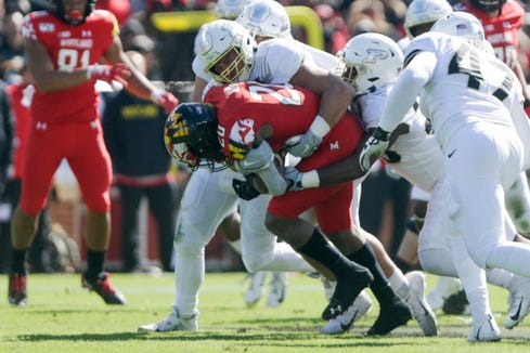 Purdue defensive end George Karlaftis (5) tackles Maryland running back Javon Leake (20) during the first quarter of a NCAA football game, Saturday, Oct. 12, 2019 at Ross-Ade Stadium in West Lafayette.
