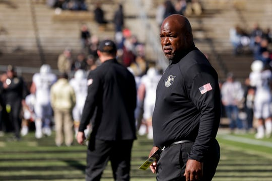Purdue assistant coach Reggie Johnson watches warm ups prior to a NCAA football game between the Purdue Boilermakers and the Maryland Terrapins, Saturday, Oct. 12, 2019 in West Lafayette.
