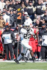 Purdue cornerback Cory Trice returns an interception for a touchdown late in the first half of the Boilermakers' 40-14 Homecoming win over Maryland.