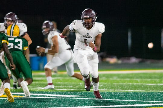 Breaux Bridge High's Trevonte Sylvester runs down the field during the play as the Breaux Bridge Tigers take on the Cecilia Bulldogs on Friday, Oct. 11, 2019.