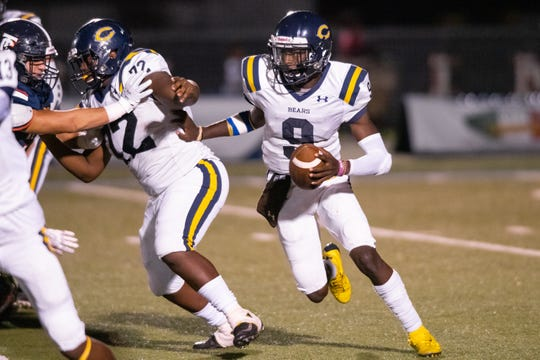 Carencro High's Tavion Faulk keeps the ball and drives it down the field as the Teurlings Catholic Rebels take on the Carencro High Bears on Friday, Oct. 11, 2019.