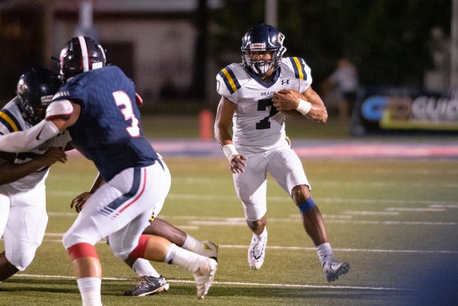 Carencro High's Kendrell Williams drives the ball down the field as the Teurlings Catholic Rebels take on the Carencro High Bears on Friday, Oct. 11, 2019.