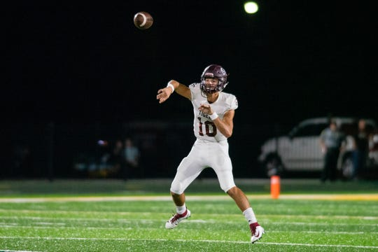 Breaux Bridge High's Gavan Courville throws a pass to an open receiver as the Breaux Bridge Tigers take on the Cecilia Bulldogs on Friday, Oct. 11, 2019.