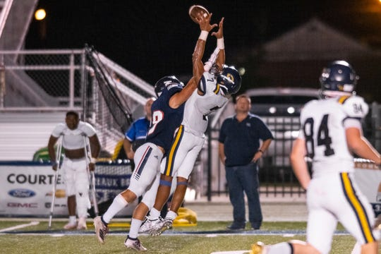 Carencro High's Kendrell Williams goes up for the pass as the Teurlings Catholic Rebels take on the Carencro High Bears on Friday, Oct. 11, 2019.