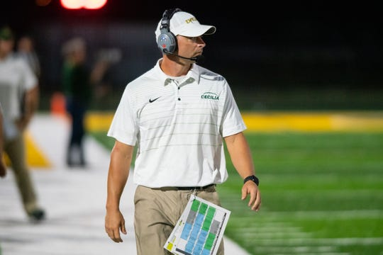 Cecilia High head coach Dennis Skains walks down the sideline during the game as the Breaux Bridge Tigers take on the Cecilia Bulldogs on Friday, Oct. 11, 2019.