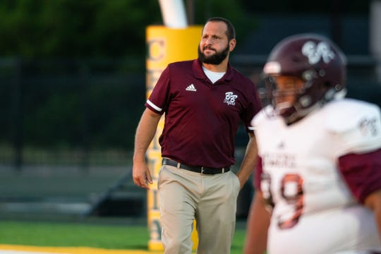 Breaux Bridge High's head coach Chad Pourciau watches his players warm up before the game as the Breaux Bridge Tigers take on the Cecilia Bulldogs on Friday, Oct. 11, 2019.