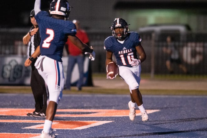 Teurlings Catholic's TyRick Gary (10) runs into the end zone to score a touchdown as the Teurlings Catholic Rebels take on the Carencro High Bears on Friday, Oct. 11, 2019.