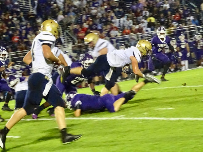Lancaster's Owen Snyder fights for yardage Friday against Pickerington Centtral. The Golden Gales fell, 34-0.