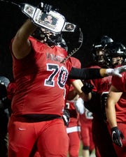 Pinckney lineman Mason Bell celebrates after recovering a fumble in a 49-25 loss to Dexter on Friday, Oct. 11, 2019.