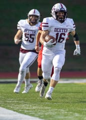 Dexter running back Evan Krolewski runs 84 yards for a touchdown on the second play from scrimmage in a 49-25 victory at Pinckney on Friday, Oct. 11, 2019.