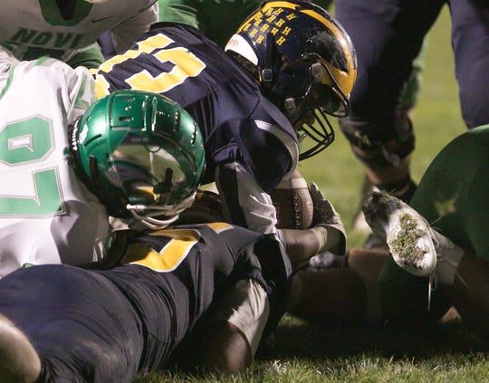 Hartland's Isaac Elmore (13) was used as a wildcat quarterback and scored the Eagles' second touchdown in a 14-0 victory over Novi on Friday, Oct. 11, 2019.