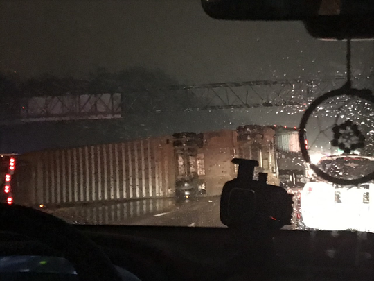 A semitruck carrying 92 pigs overturned on Interstate 64 East near downtown Louisville Friday, Oct. 11, 2019.