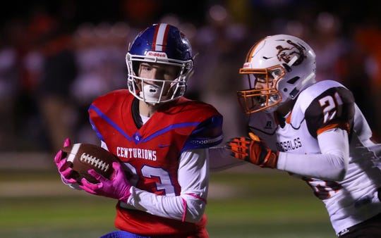 CAL's Gage Geren hauls in the ball against DeSales' Caleb Winebrenne to set up the touchdown on Oct. 11, 2019.