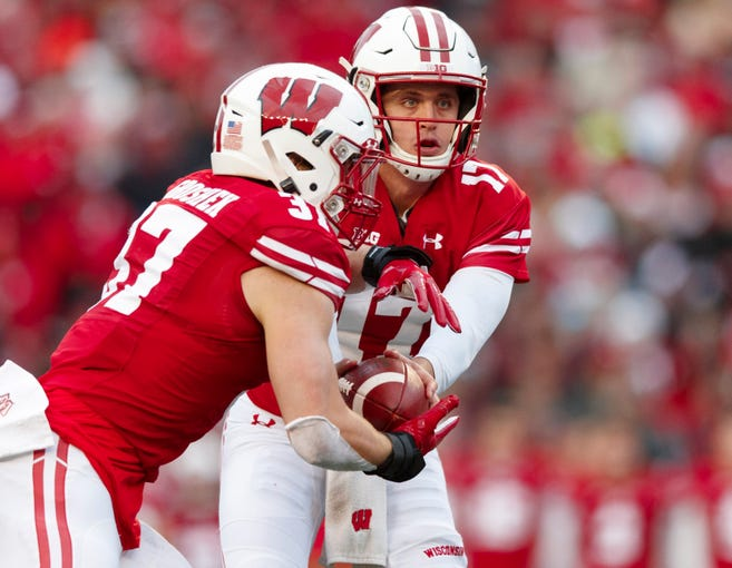 Oct 12, 2019; Madison, WI, USA; Wisconsin Badgers quarterback Jack Coan (17) hands the football off to running back Garrett Groshek (37) during the third quarter against the Michigan State Spartans at Camp Randall Stadium. Mandatory Credit: Jeff Hanisch-USA TODAY Sports