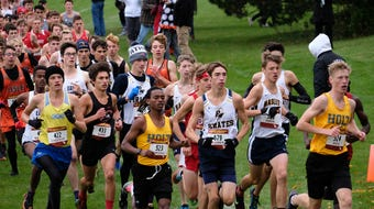 See some of the action from the boys race and hear remarks from Holt's Alex Penski and Haslett's Stephen Henry.