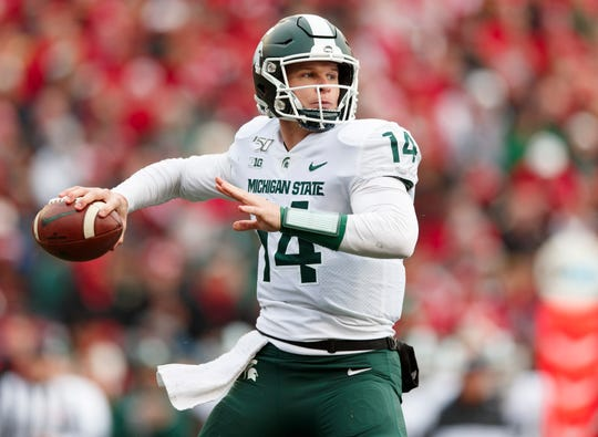 Oct 12, 2019; Madison, WI, USA; Michigan State Spartans quarterback Brian Lewerke (14) throws a pass during the second quarter against the Wisconsin Badgers at Camp Randall Stadium. Mandatory Credit: Jeff Hanisch-USA TODAY Sports